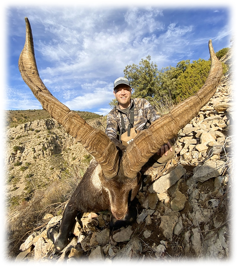 Hunter with his Beceite ibex hunting trophy