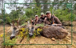 Hunters with their last successful hunt of roe deer in Spain